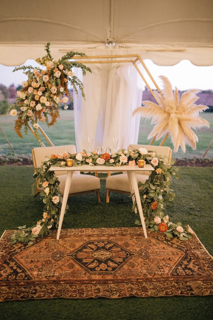 boho sweetheart table with pampas and eucalyptus