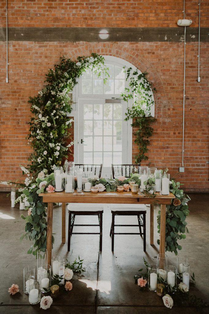 sweetheart table flower installation