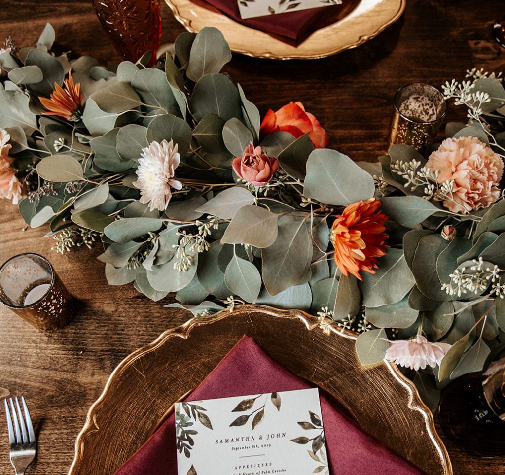 sweetheart table with fall flowers and eucalyptus garlands